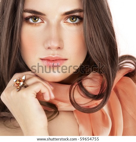 Beauty with ring and salmon color scarf