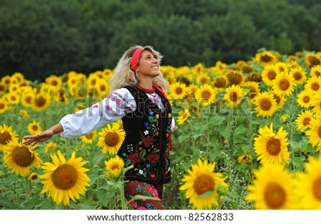 Beauty woman and sunflowers
