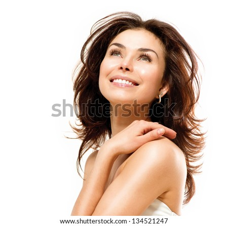 Beauty Woman. Beautiful Young Female touching Her Skin. Portrait isolated on White Background. Healthcare. Perfect Skin. Beauty Face. #134521247
