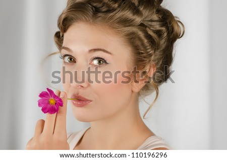 beauty woman closeup portrait with flower over grey background