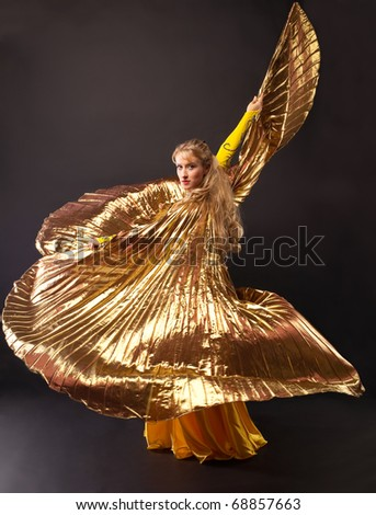 Beauty woman dance with gold wing