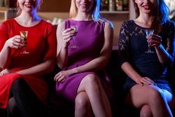 Beauty woman drinking shots in the bar
