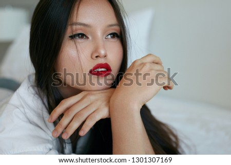 Beautiful asian model with red lips makeup #1301307169