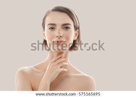 Beauty Woman face Portrait. Beautiful model Girl with Perfect Fresh Clean Skin color lips purple red. Blonde brunette short hair Youth and Skin Care Concept. Isolated on beige background