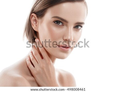 Stock Photo Beauty Woman face Portrait. Beautiful Spa model Girl with Perfect Fresh Clean Skin. Female looking at camera and smiling. Youth and Skin Care Concept