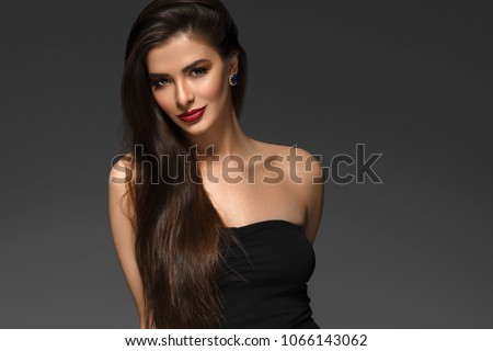 Beauty Woman face Portrait. Beauty Spa model Girl with Perfect Fresh Clean Skin. Brunette female red lipstick smiling on gray background. Beautiful hairstyle Youth and Skin Care