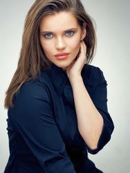 Beauty woman face portrait isolated on studio background. Fashion young model.
