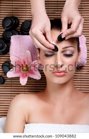 beauty woman having cosmetic massage,facial treatment, close up