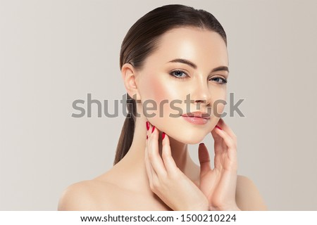 Beauty woman healthy skin concept natural makeup beautiful model girl face hands touching woth manicure nails