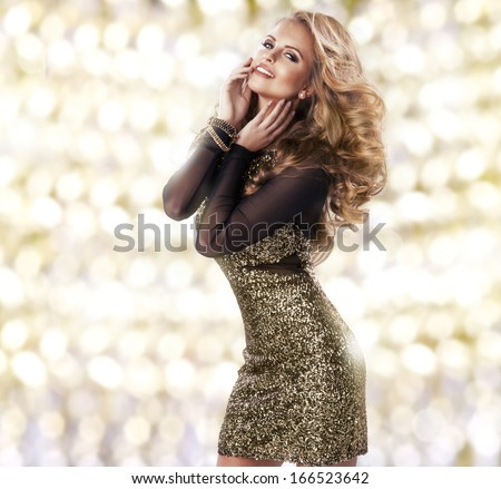 Beauty  woman in gold dress - stock photo