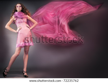 beauty woman in pink dress shooting mix light