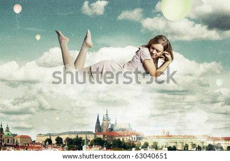 beauty woman in the clouds over Prague