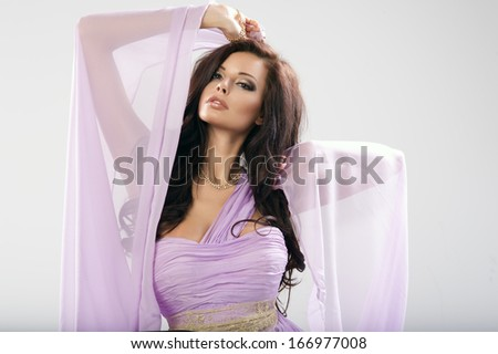 Beauty woman in violet dress.  - stock photo