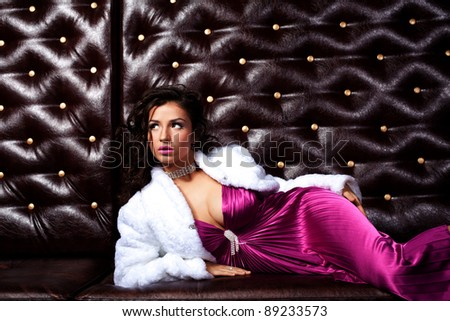 Beauty woman lay on leather sofa