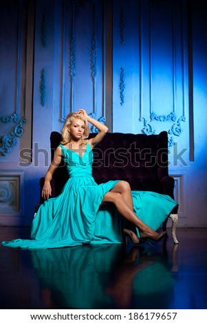 Beauty woman like a princess in the palace. Luxurious rich fashion stylish girl in a long evening dress.