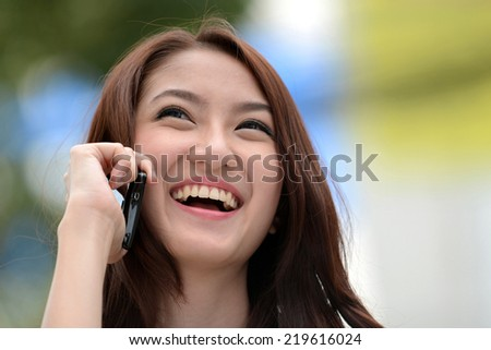Beauty woman on phone laughing smile and looking up