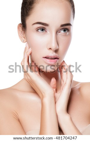 Beauty Woman Portrait. Beautiful Spa Girl Touching her Face and smiling. Perfect Fresh Skin. Pure Beauty Model Female looking to side. Youth and Skin Care Concept. Isolated on background