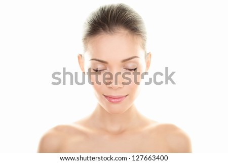 Beauty woman portrait. Skin and face care concept with beautiful serene multiracial woman closing eyes relaxing isolated on white background. Caucasian / Asian Chinese female beauty model relaxed.