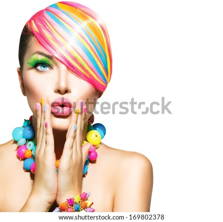 Beauty Woman Portrait With Colorful Makeup, Hair, Nail Polish And Accessories. Colourful Studio Shot Of Funny Model Girl. Vivid Colors. Manicure And Hairstyle. Rainbow Colors