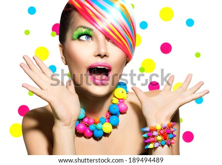 Beauty Woman Portrait with Colorful Makeup, Hair, Nail polish and Accessories. Colourful Studio Shot of Girl Woman. Vivid Colors. Manicure and Hairstyle. Rainbow Colors. Open Mouth, Emotions