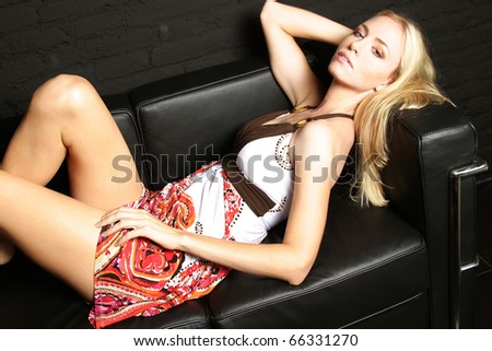 Beauty woman relaxing on a sofa. #66331270