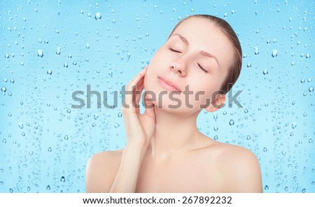 Beauty woman, skin care and freshness background with splash water drops, female portrait enjoying clean skin