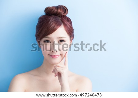 beauty woman smile to you isolated on bluebackground, asian