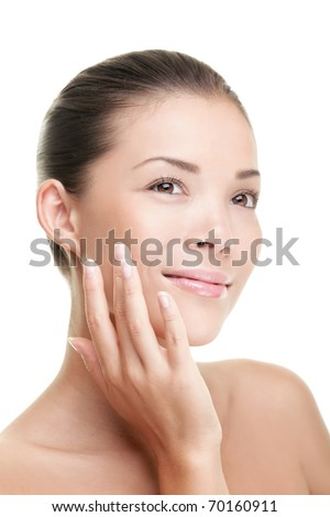 Beauty woman smiling applying cream. Beauty portrait of beautiful mixed-race Asian / Caucasian female model isolated on white background looking away.