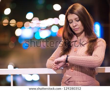beauty woman wath to clock wait date