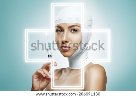 beauty woman with bandaged head holding injection. Glowing cross