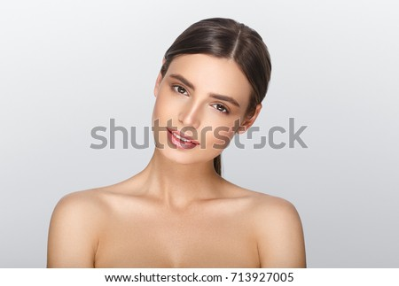 Beauty woman with healthy skin portrait isolated over gray background