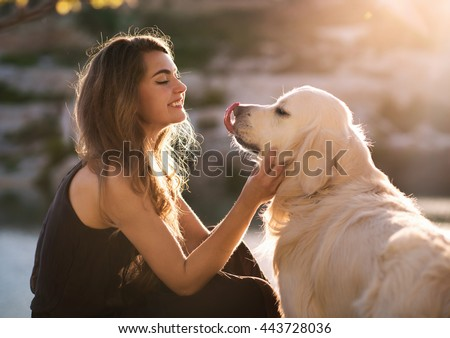 Beauty woman with her dog playing outdoors #443728036