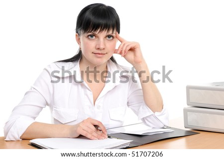 beauty woman with long hair sits at a table with the book and writes - stock photo
