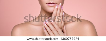 Beauty Woman with perfect Makeup and Manicure. Glamour Girl. Pink Lips and Nails. Skin care foundation. Beauty girls Face isolated on light Background. Fashion photo