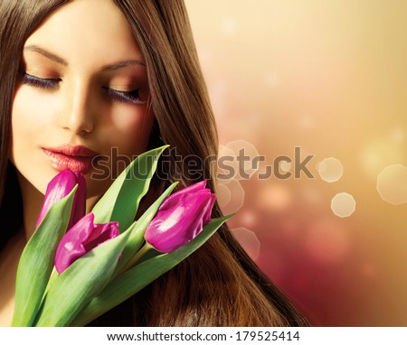 Beauty Woman with Spring Flower bouquet Beautiful girl with a Bouquet of Tulip flowers Isolated on a white background Happy surprised model woman smelling flowers Mothers Day Easter holiday