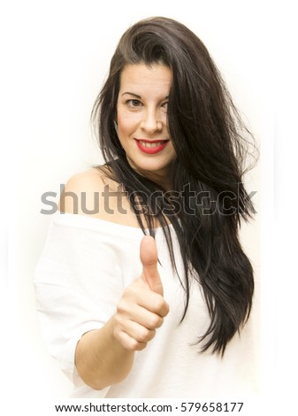 Beauty Woman With the thumb up sign of optimism Portrait Isolated over White Background #579658177