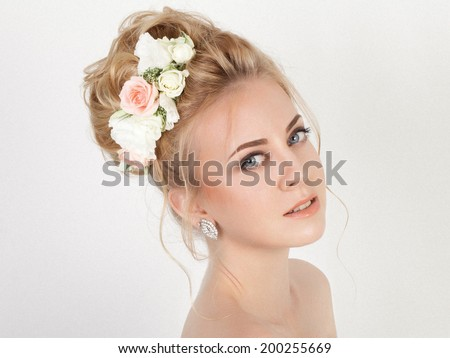 Beauty woman with wedding hairstyle and makeup. Bride fashion. Jewelry and Beauty. Woman in white dress,perfect skin, blond hair. Girl with stylish haircut.