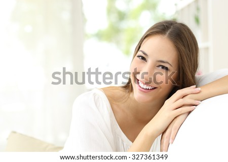 Beauty woman with white perfect smile looking at camera at home #327361349