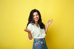 Beauty women portrait in a studio, isolated, yellow color, red lips, cute, happy face, smile, beauty brunette female, home, denim, cute. hair pretty, red lips, emotional portrait, love