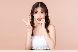 Beauty young asian woman has two pigtails and smiles clean fresh bare skin concept. Asian girl beauty face skincare and health wellness, Facial treatment, Perfect skin, Isolated on beige background.