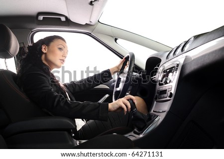 beauty young businesswoman drive the car. you can set any background in place of white windows