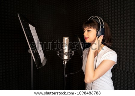 Beauty Young Dubbing Artist Girl In Recording Studio Talking Into Microphone Stok fotoğraf ©