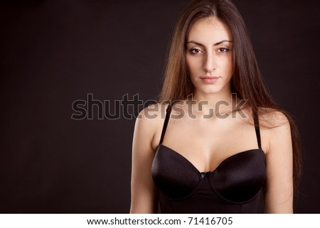 Beauty young girl face on dark background #71416705