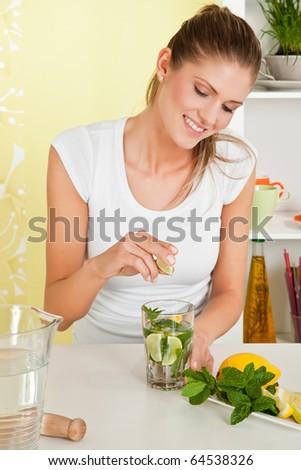 Beauty, young girl making lemon water