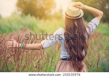Beauty young girl outdoors enjoying nature