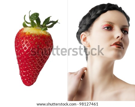 beauty young girl with a floral makeup. She is turned of three quarters and looks in to the lens with attractive expression