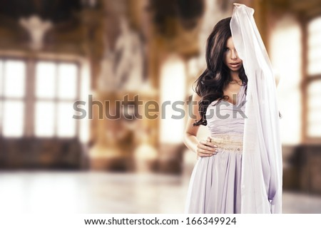 Beauty young lady posing in a stylish interior