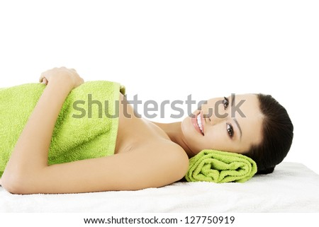 Beauty young woman relaxing in spa. Isolated on white.