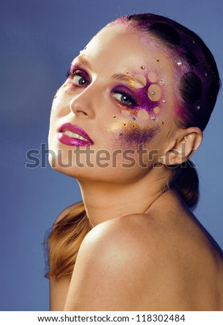 beauty young woman with creative make up