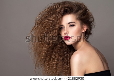 Beauty Young Woman With Curly Big And Long Hair Permed Hair